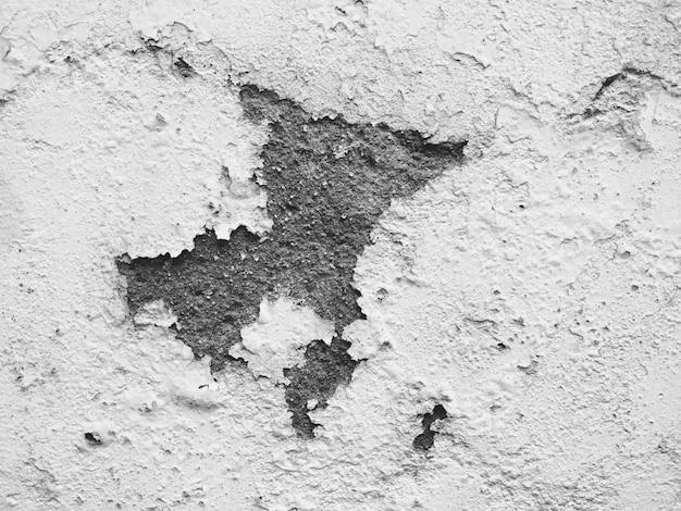 Textura de fondo de yeso de pared blanca dañada