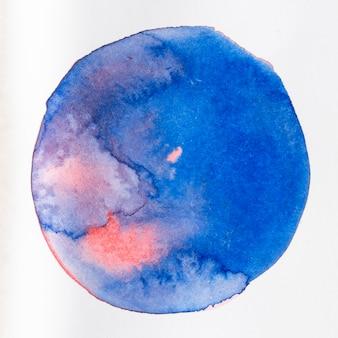 Textura de forma redondeada azul aguada sobre lienzo
