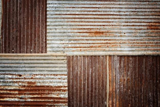 Textura galvanizada dañada vieja y oxidada textura grunge de metal oxidado viejo con fondo de rayas y grietas, tonos de color.