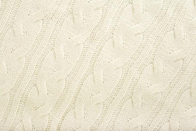 Textura de lana de tejido de punto beige para el fondo.