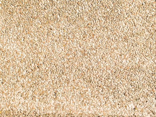Textura lavada fondo de arena. textura: textura de piedra de guijarros. fondo de textura de playa de arena. diseño de concepto de naturaleza de decoración de pared