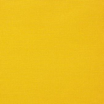 Textura de lienzo amarillo para el fondo