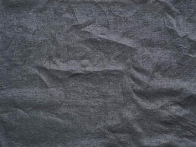 Textura de lino gris como fondo. mantel arrugado de lino gris.