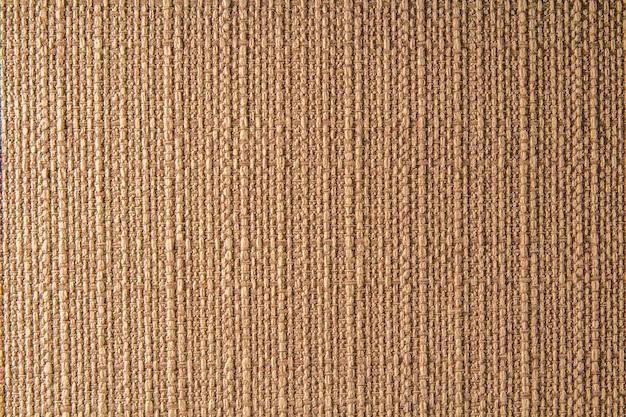 Textura de lino de tela natural para el diseño, textura de tela de saco. fondo de lona marrón. algodón.