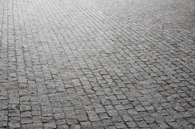 La textura de la losa de pavimento (adoquines) de muchos