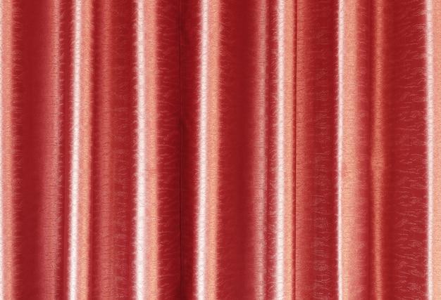 La textura de lujo de la cortina de seda del oro color de rosa para el fondo y el trabajo de arte del diseño.