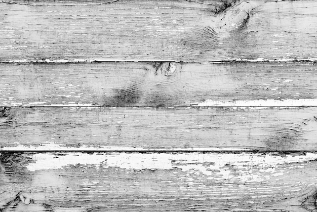 Textura de madera de color gris con rayas y grietas, que se puede utilizar como fondo