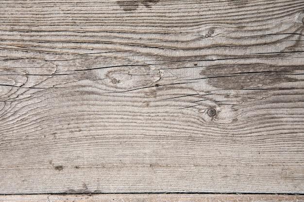 Textura de madera gris con grietas
