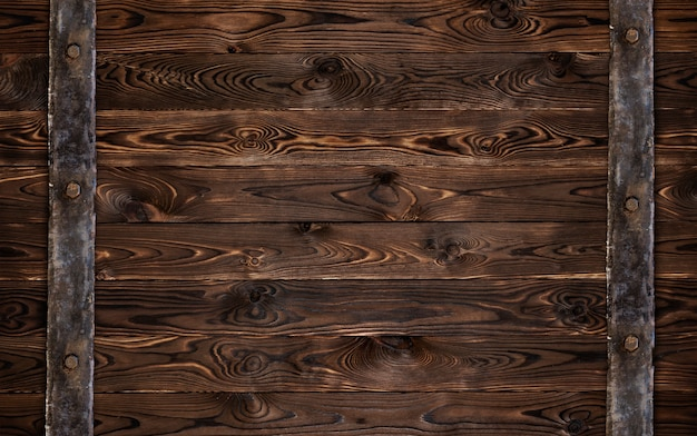 Textura de madera oscura con elementos de metal antiguo