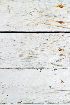 Textura de madera pintada blanca rasguñada vapor del mar.