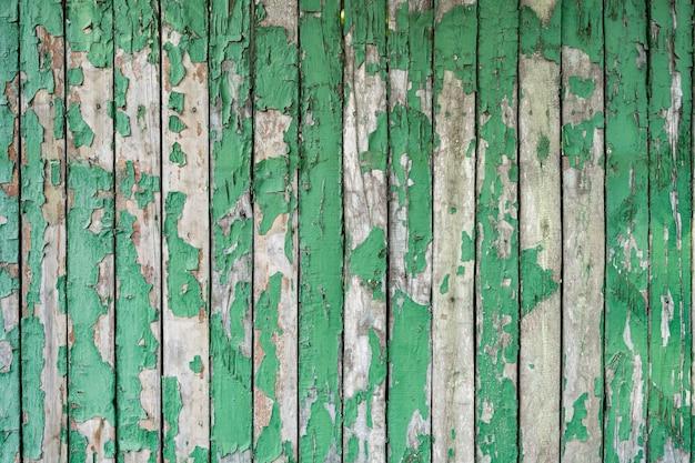 Textura de madera pintada de verde de la pared de madera de fondo y textura.