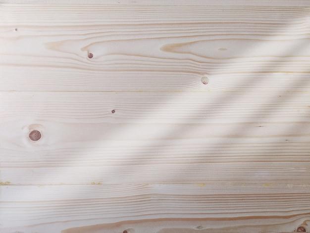 Textura de madera con sombra de luz de ventana