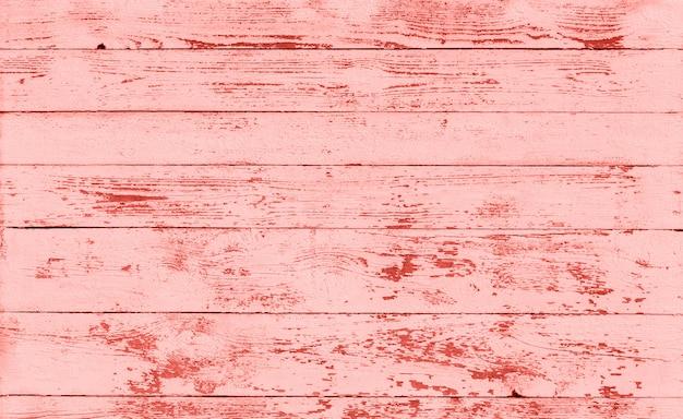 Textura de madera tonificada al color coral vivo.