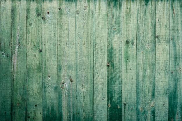 Textura de madera verde o fondo.