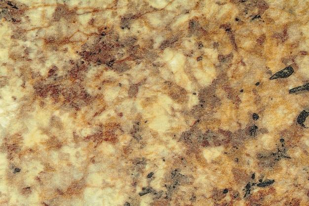 Textura de mármol marrón claro y amarillo con patrón