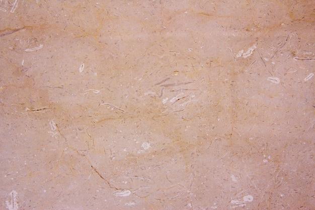 Textura de mármol en tonos beige. fondo. diseño de interiores moderno. loseta.