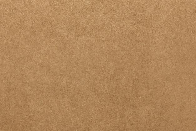 Textura marrón clara del papel de kraft para el fondo