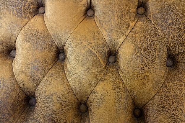 Textura marrón claro del sofá del vintage, fondo del sofá del cuero marrón del modelo