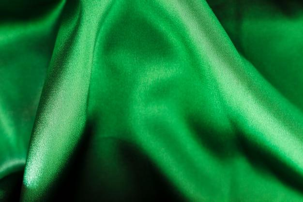 Textura de material de tela verde con espacio de copia