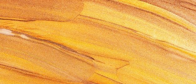 Textura metálica brillante abstracta. fondo naranja bronce con manchas brillantes