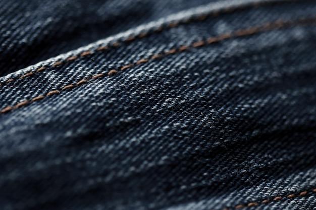 Textura de mezclilla de jeans de cerca, enfoca solo un punto