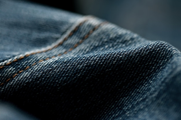Textura de mezclilla de jeans de cerca, enfoque solo un punto, fondo borroso suave