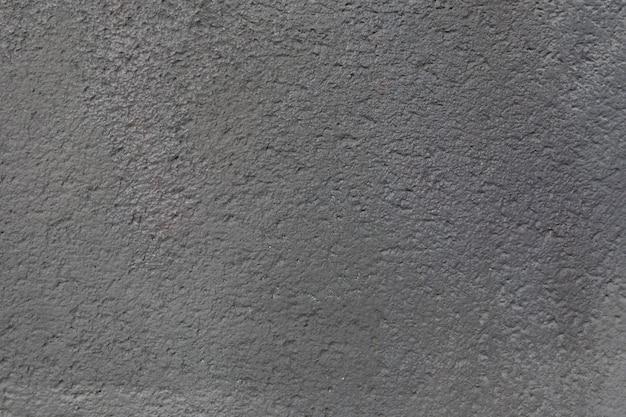 Textura de muro de hormigón con baches grises para diseñador