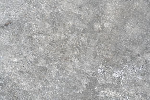Textura de un muro de hormigón blanco liso con grietas como fondo o papel tapiz. fondo abstracto de muro de hormigón gris claro y textura suave grunge cemento pulido al aire libre