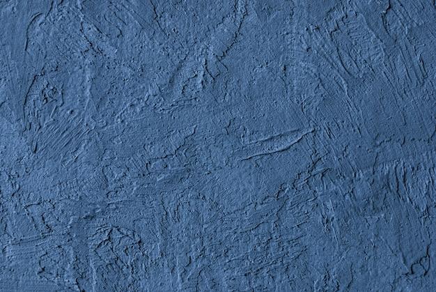 Textura de muro de hormigón desigual azul gris