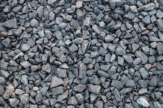 Textura natural de la superficie del suelo de la roca de la piedra del guijarro
