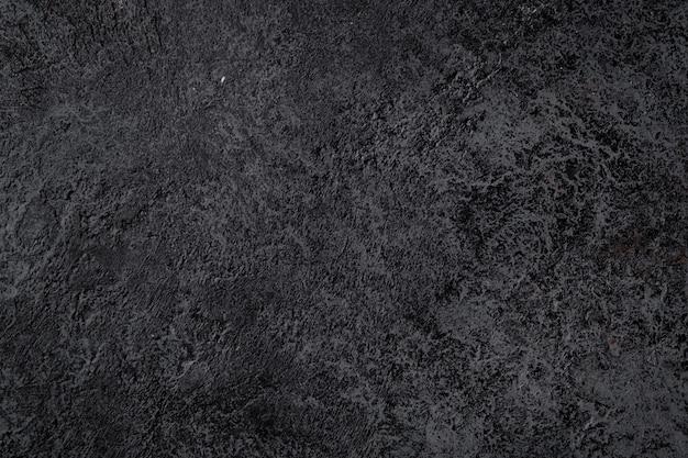 Textura negra de la superficie de piedra volcánica