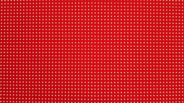 Textura de panel de pantalla led rgb. primer plano de una pantalla led de píxeles con bokeh para fondo de pantalla. fondo abstracto rojo brillante perfecto para cualquier diseño.