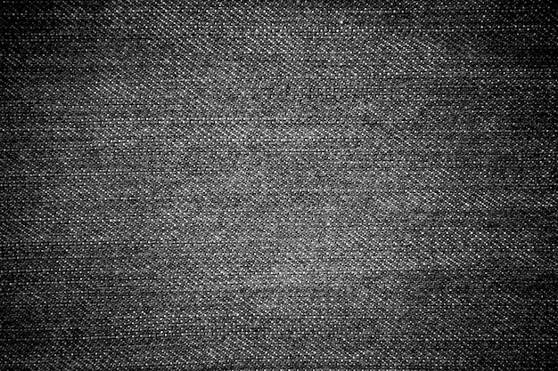Textura de los pantalones vaqueros del dril de algodón negro para el fondo