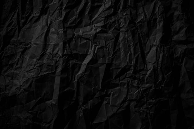 Textura de papel arrugado negro oscuro de cerca