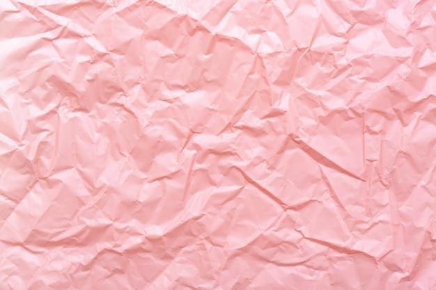 Textura de papel arrugado rosa resumen de antecedentes