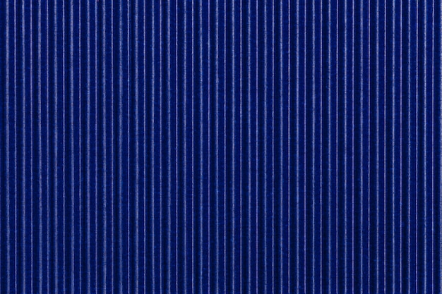 Textura de papel azul corrugado. fondo rayado