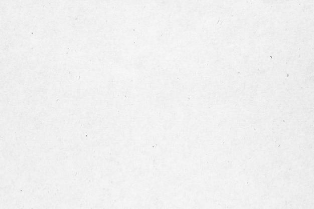 Textura de papel blanco o cartón con fondo de mancha negra.
