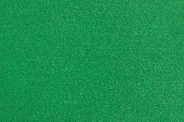 La textura del papel de color verde.