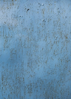Textura de pared azul pintada agrietada