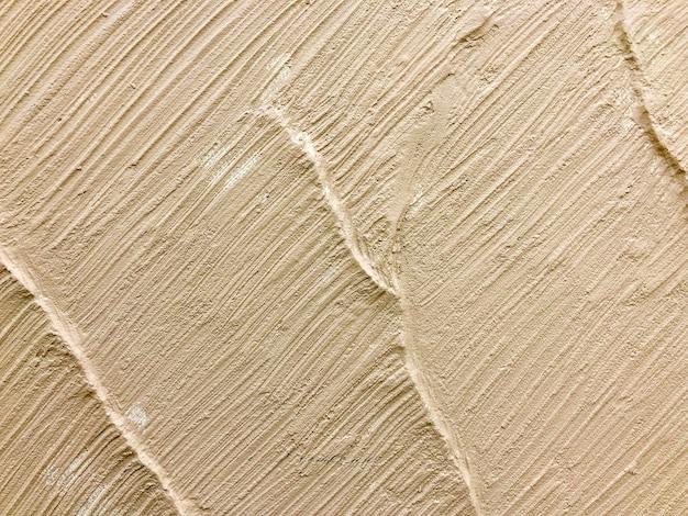Textura de pared de color marrón claro o crema para el fondo.