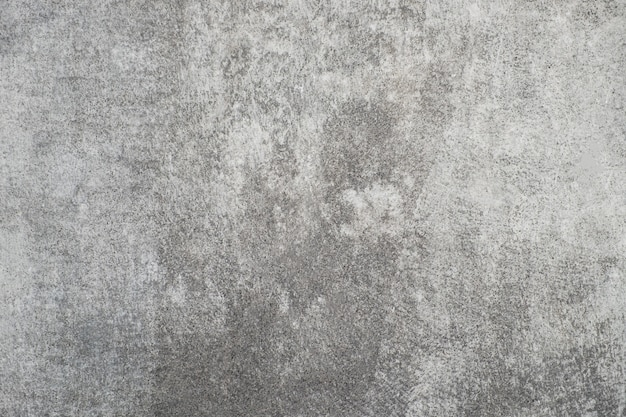 Textura de la pared concreta gris vieja del estuco.