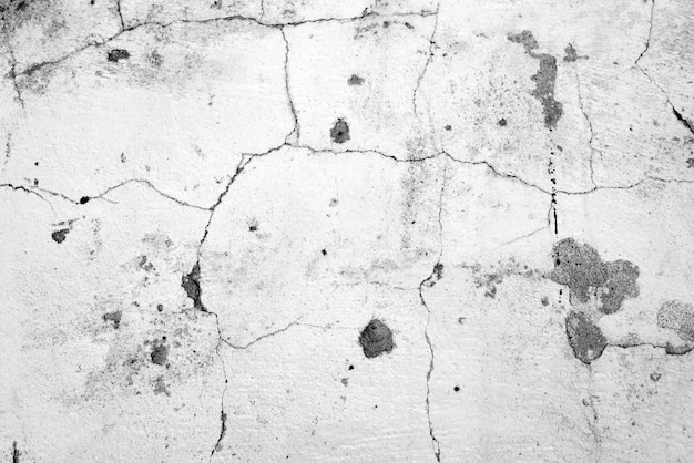 Textura, pared, fondo de hormigón. fragmento de pared con rasguños y grietas.
