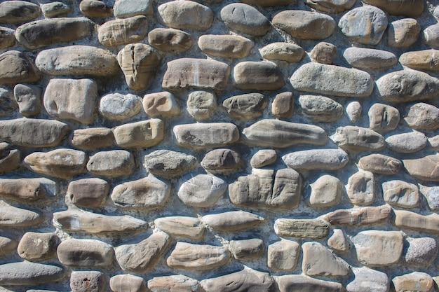 Textura de una pared de una gran piedra gris