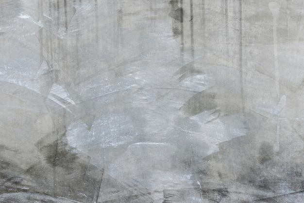 Textura de una pared gris vieja para el fondo