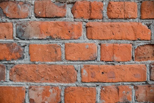 Textura de pared de ladrillo. cerca de la antigua muralla de ladrillos rojos, fondo. enladrillado