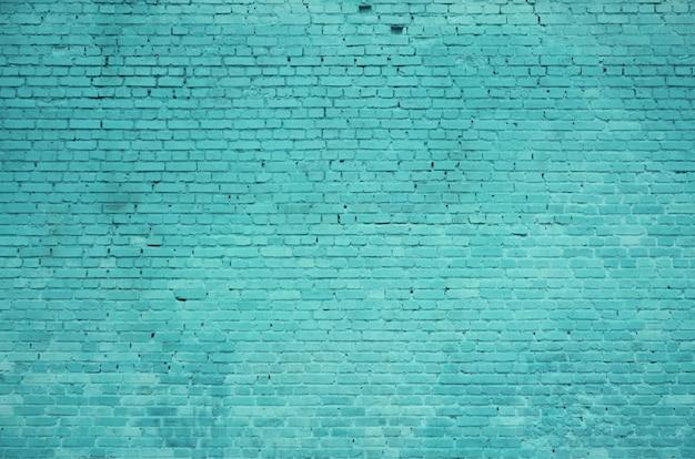 La textura de la pared de ladrillo de muchas filas de ladrillos pintados de fondo