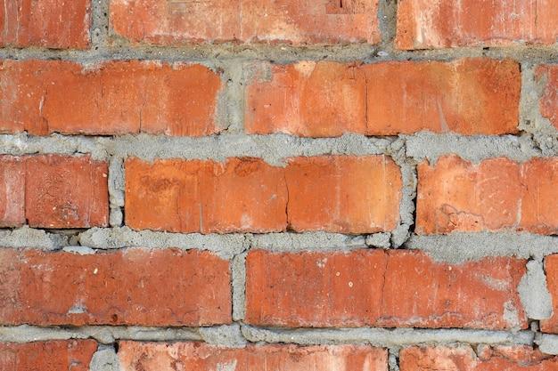 Textura de pared de ladrillo naranja con mampostería sucia desigual