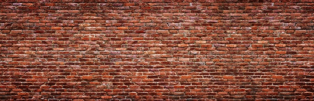 Textura de pared de ladrillo vintage. fondo panorámico de piedra vieja.