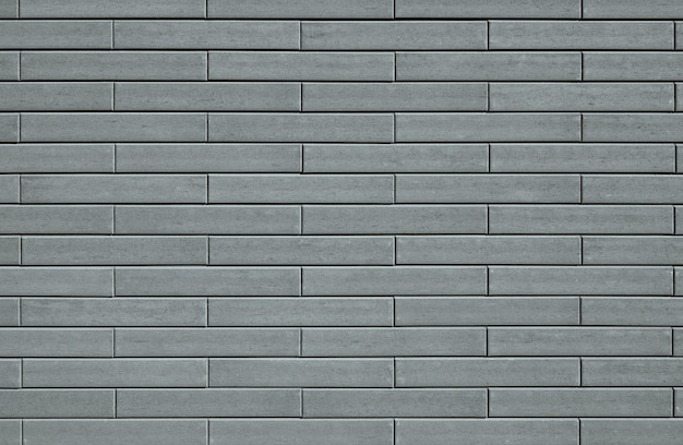 Textura de pared de ladrillos decorativos grises
