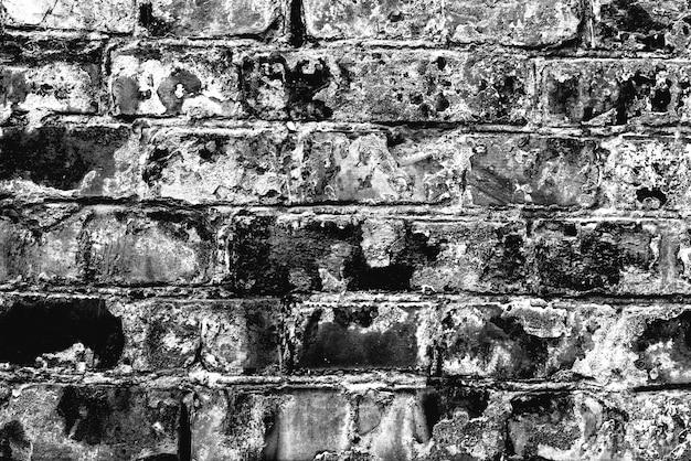 Textura de una pared de ladrillos con grietas y arañazos